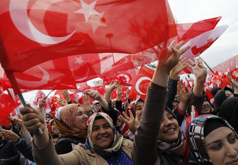 Supporters of Turkish President Erdogan wave national flags during a rally for the upcoming referendum in Konya