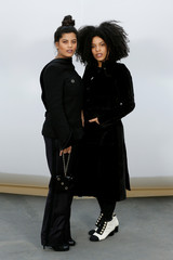 Lisa-Kainde Diaz and Naomi Diaz pose during a photocall before the French fashion house Chanel Fall/Winter 2017-2018 women's ready-to-wear collection show during Fashion Week in Paris