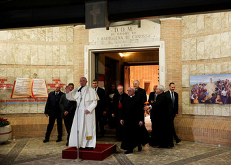 Pope Francis waves at the end of his visit at the Borgata Ottavia in the outskirts of Rome