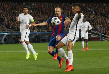 Barcelona's Andres Iniesta before Paris Saint-Germain's Layvin Kurzawa scores an own goal and the second for Barcelona