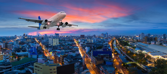 Airplane take off over the panorama city at twilight scene Wall mural