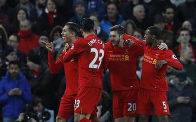 Liverpool's Roberto Firmino celebrates scoring their first goal with team mates