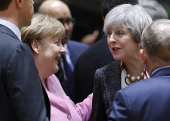 British Prime Minister Theresa May and German Chancellor Angela Merkel attend the EU summit in Brussels
