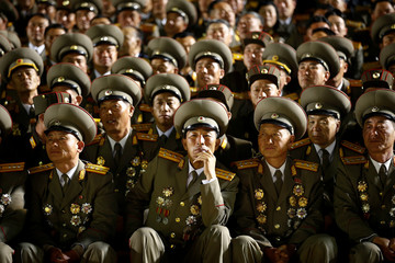 Military officers follow a mass dance event marking the 105th birth anniversary of the country's founding father, Kim Il Sung, in Pyongyang
