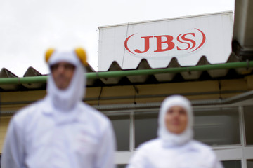 Employees are seen during a technical visit of Brazil's Agriculture Minister Blairo Maggi at the Brazilian meatpacker JBS SA in the city of Lapa