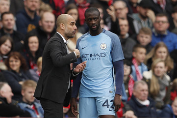 Manchester City manager Pep Guardiola and Manchester City's Yaya Toure
