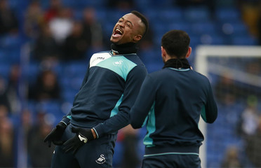 Swansea City's Jordan Ayew warms up before the match