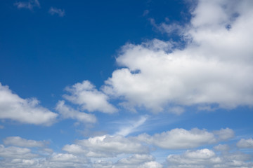 Blue sky with flying clouds over horizon, heaven.