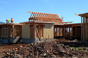 Construction workers build a single family home in San Diego, California