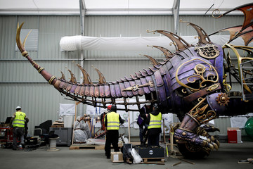 Employees work on the Dragon's char for the Disney Stars on Parade, the new parade to celebrate the 25th anniversary of the park, at the Chars Workshop in Disneyland Paris in Marne-la-Vallee