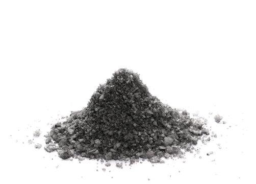 Black volcanic salt pile isolated on white background