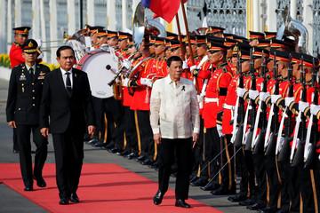Thailand's Prime Minister Prayuth Chan-ocha welcomes Philippine President Rodrigo Duterte at the Government House in Bangkok