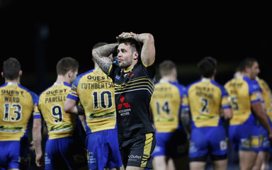 Gareth O'Brien of Salford Red Devils looks dejected following Leeds' third try