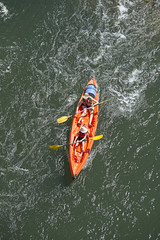 Directly above shot of woman and child rowing kayak in water