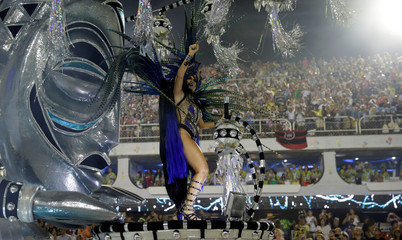 A reveller from Vila Isabel samba school performs during the carnival parade at the Sambadrome in Rio de Janeiro