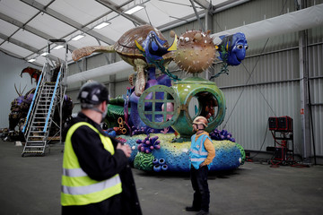 Employees stand in front of the Finding Nemo & Finding Dory's Char for the Disney Stars on Parade, the new parade to celebrate the 25th anniversary of the park, at the Chars Workshop in Disneyland Paris in Marne-la-Vallee