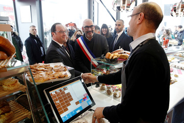 French President Francois Hollande visits a bakery in Ivry sur Seine