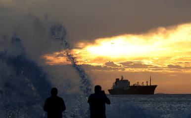 People take photograph during the sunset in Fortaleza