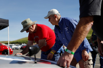 Technicians work on a vehicle during a self-racing cars event in Willows, California