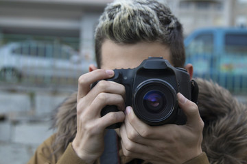 close-up of the photographer with the SLR camera