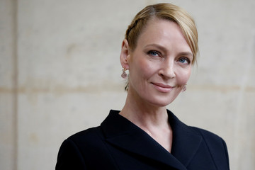 Actress Uma Thurman poses during a photocall before French fashion house Christian Dior Fall/Winter 2017-2018 women's ready-to-wear collection during Fashion Week in Paris