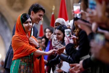Pakistani Nobel Peace Prize laureate Yousafzai and Canada's PM Trudeau greet onlookers on Parliament Hill in Ottawa