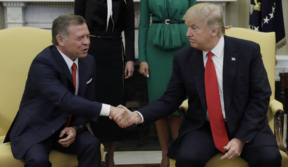 U.S.  President Donald Trump and first lady Melania Trump meet with Jordan's King Abdullah and Queen Rania at the White House in Washington