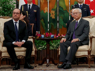 French President Francois Hollande and Singapore President Tony Tan Keng Yam meet in the Istana Presidential Palace in Singapore
