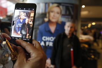 Supporters for Marine Le Pen, French National Front (FN) political party leader and candidate for French 2017 presidential election, take a souvenir photo before a campaign rally in Nice