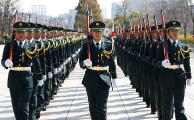 Members of Japan's Self-Defence Force's honour guard prepare for a ceremony for Russian Defence Minister Shoigu at the Defense Ministry in Tokyo