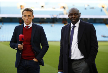 TV pundits Phil Neville and Shaun Goater before the match