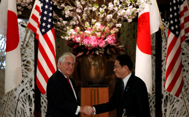 U.S. Secretary of State Tillerson shakes hands with Japan's FM Kishida at their joint news conference after their meeting at the foreign ministry's Iikura guest house in Tokyo
