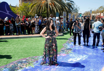 """Actor Demi Lovato, who voices the Smurfette character, poses at the premiere of the film """"Smurfs: The Lost Village"""" in Culver City, California"""