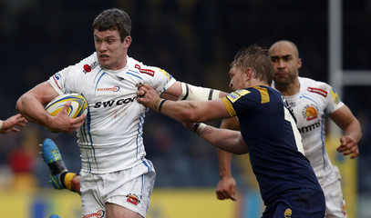 Exeter's Ian Whitten gets past a tackle from Worcester's Dewald Potgieter