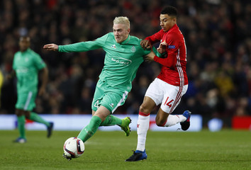 Manchester United's Jesse Lingard in action with St Etienne's Jordan Veretout