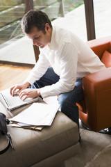 Man Working on Laptop in Modern Living Room