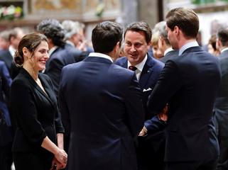 Luxembourg Prime Minister Bettel and his husband Destenay speak with Greece's Prime Minister Tsipras and his partner Peristera Baziana as they wait for the start of an audience with Pope Francis at the Vatican
