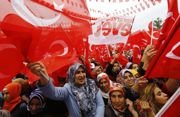 Supporters of Turkish President Tayyip Erdogan wave Turkey's national flags as they wait for the start of a rally for the upcoming referendum in the Kurdish-dominated southeastern city of Diyarbakir
