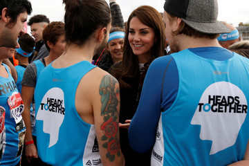 Britain's Catherine, Duchess of Cambridge, greets runners representing the charity 'Heads Together' before officially starting the 2017 London Marathon