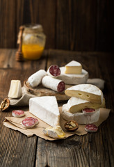 Assorted cheese and salami with honey
