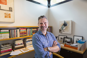 Portrait of smiling Caucasian man in home office