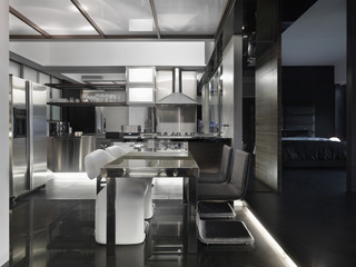 Modern black and white kitchen and dining area