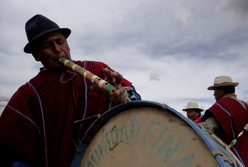 """A musician plays a """"pinkillo"""" during a ceremony to promote sweet quinoa at the Canaviri district in La Paz"""