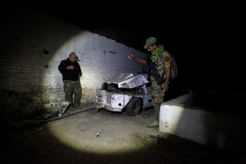 Members of the rapid response forces inspect a tunnel that was used by Islamic State militants as underground training camp in the hillside overlooking Mosul