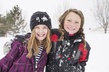 Portrait of girls hugging in winter