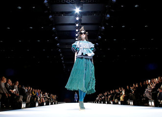 A model presents creation by designer Yuma Koshino from her Autumn/Winter 2017 collection during Tokyo Fashion Week in Tokyo