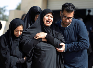 Family members of Abdulla Al Ajooz cry during his funeral procession in the village of Nawidarat south of Manama