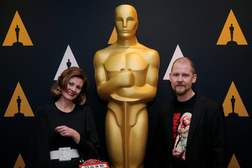 """Von Bahr and Larson, nominated for the Academy Award for Makeup and Hairstyling for the movie """"A Man Called Ove,"""" pose for photographs at a reception for nominees before the 89th Academy Awards in Los Angeles"""