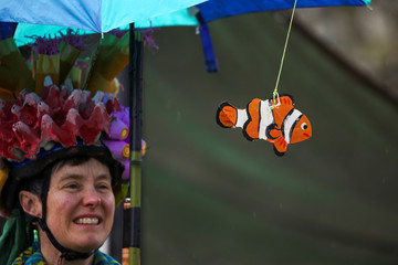 A cardboard clownfish hangs from the umbrella of Karen Lewis, who came to the March For Science dressed as a coral reef, in Seattle, Washington