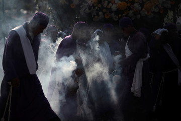 Members of various brotherhoods participate in the Los Cristos Procession as part of Holy Week celebrations in Izalco